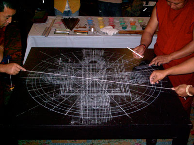 Tibetan monks, using sacred geometry, lay out a grid pattern for the construction of a mandala